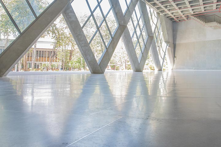 When it comes to the benefits of commercial polished concrete flooring, you are essentially looking at two major things. The first is the fact that this type of flooring is a great deal more durable than other types of flooring. It is a true floor covering that can last for a very long time when it is properly maintained. Also, it can be left in place for a very long time and as a result, it will not need to be replaced as often. Because of these two things, you can see why this could be a real benefit for any business. However, there are some other benefits of this flooring too. One of those is the fact that it will protect the concrete from stains. Some stains can be very difficult to remove, so this type of floor covering can help out in that regard. The best part is that the concrete will also look great in most cases. As previously mentioned, this type of flooring can last for a very long time, but it can also provide the business with an added layer of protection to the concrete as well. If something were to fall on the concrete, it is very possible that the concrete itself would be damaged. However, with this particular type of coating, that is not going to happen at all. Of course, another one of the benefits of commercial polished concrete flooring is its appeal. This particular surface has been designed to appeal to just about anyone. This means that it can work just about anywhere that other types of floors might not be able to fit. In fact, you might think that this is already a benefit because it does mean that there is a wide range of places that you could put this type of flooring. However, another thing that can be beneficial is that you would have a very durable and long lasting floor covering. Finally, this type of flooring can also work to create additional benefits. This would include an appeal to those who would not otherwise consider getting a concrete floor covering. As mentioned before, it is very easy to install this type of covering over the top of an existing concrete floor. This can help you to create the appearance of a much more expensive luxury floor in many cases. However, you would still have the benefits of the appeal that this surface has to offer. As you can see, there are many benefits of commercial polished concrete flooring. This form of flooring can work to provide many different benefits to you and your business. It can easily fit into just about any place, can work to help to protect the environment, and can be attractive and easy to use. These benefits make it well worth your time to consider getting this type of floor covering for your business or other needs.
